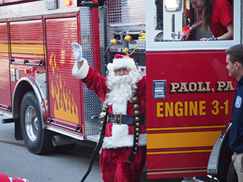 Santa arrives compliments of a Paoli Fire Company Fire Engine
